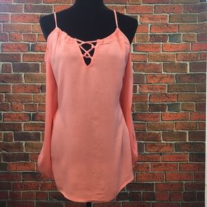 Peach peek-a-boo shoulder top